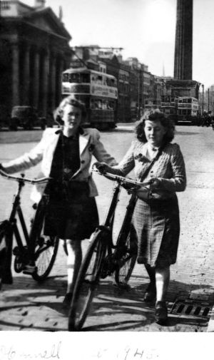 1945  - My mother, Mary Ryan (née Noonan), on the left, and her best friend, Josie Leddin, from Howardstown, Bruree, County Limerick. My mother was a Munster champion cyclist in her day and competed in cross-country bicycle races. The two friends had taken their bicycles to Dublin on the train to visit Mary's sister. In 1945, during the Emergency, trains had more space for bicycles than for humans as cycling was such an important part of life. -  Madge Ryan