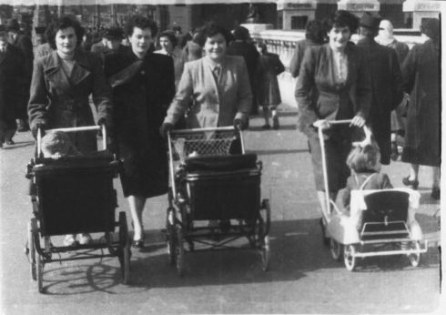 1954  - The Dufficy sisters from Tulsk, County Roscommon. Left to right: Eileen O'Shea, Martha Casserly, May Donaldson and Kathleen Donaldson. I am the toddler in the pushchair, my brother Robert is in the middle pram and in the other pram is my cousin George Casserly, who sadly drowned at the age of two, about ten months after this photo was taken. My mam Kathleen (on the right) passed away at the early age of 38 leaving four young children, and her sister May married my dad and reared myself and my three brothers. The Dufficys were a very close family and even to this day we, as cousins, keep in touch with each other. Eileen and May had a hairdresser's shop in Cabra. -  Amelia Punton