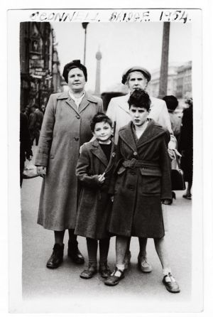 1954  - My mother (left), my aunt, my older brother and myself with a Dan Dare badge pinned to my coat. My aunt would come up from Kilkenny to our home in Crumlin and stay with us for a week or two. During that time she would take us out for ice cream to Cafolla's ice cream parlour on O'Connell Street and of course their ice creams and famous knickbocker glory were always in sundae glasses ... they were the days of old. To get the Dan Dare Badge, I pestered my dear mother to save up enough labels from Horlicks jars to qualify for it. I was a member of the Horlicks Spacemen's Club. - Eric Gurey - All images from Man on the Bridge; More Photos by Arthur Fields, compiled by Ciaran Deeney and David Clarke, published by The Collins Press, 2017