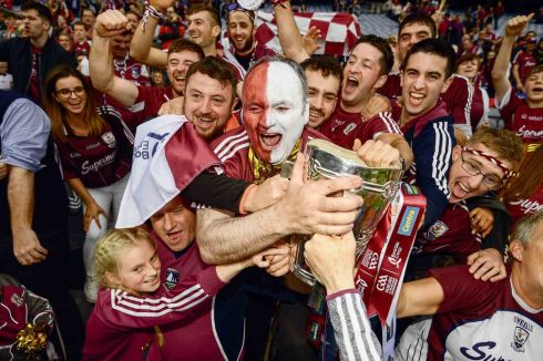 3 September 2017 - Tom Brennan, from Clarinbridge, and his fellow Galway supporters celebrate with the Liam MacCarthy Cup following the GAA Hurling All-Ireland Senior Championship Final match between Galway and Waterford at Croke Park in Dublin.  Photograph: Stephen McCarthy/Sportsfile