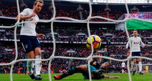 Tottenham Hotspur's English striker Harry Kane scores against Southampton at Wembley. Photograph: Getty Images