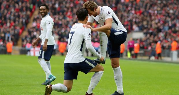 6ab1662c4c1 Heung-Min Son of Tottenham Hotspur pretents to shine Harry Kane s left boot  after the
