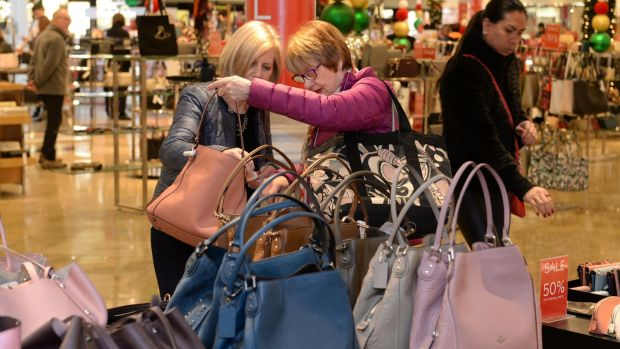 Ann Rice (left) and Maura Rice looking at bags during Arnotts Winter Sale on St Stephen's Day, at Henry Street, Dublin. Photograph: Dara Mac Dónaill/The Irish Times