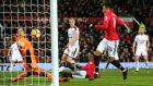 Jesse Lingard scores his first of two goals against Burnley at Old Trafford. Photograph: Alex Livesey/Getty Images