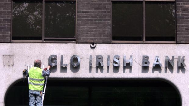 The sign being removed from the Anglo Irish Bank headquarters in St Stephen's green Dublin yesterday. Photograph: Bryan O'Brien/The Irish Times Anglo Irish Bank: Brian Lenihan told the Dáil in 2010 that bailing out this bank alone was likely to cost more than €20 billion. Photograph: Bryan O'Brien