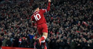 Liverpool's Philippe Coutinho celebrates scoring his side's first goal against Swansea at Anfield. Photograph: PA
