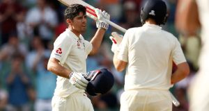 Alastair Cook of England is congratulated by Joe Root as he celebrates reaching his century. Photograph: Scott Barbour/Getty Images