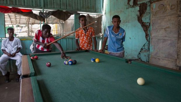 Eritrean refugees play pool in Shagarab camp, eastern Sudan. Photograph: Sally Hayden
