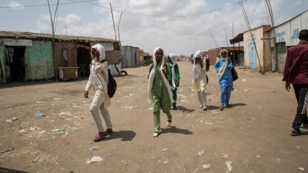 Children walk to school in Shagarab camp, eastern Sudan. Photograph: Sally Hayden