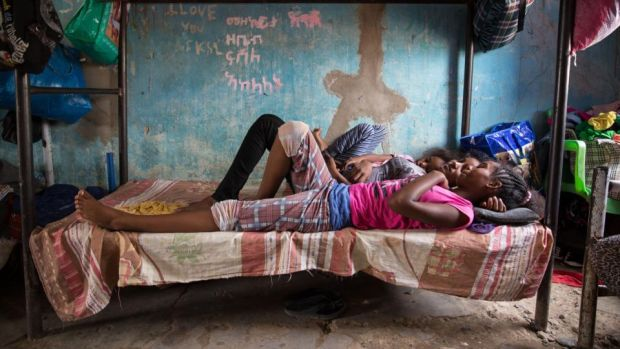 Eritrean girls chat on a bed in the unaccompanied minors section of Shagarab refugee camp, eastern Sudan. Photograph: Sally Hayden