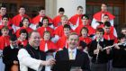 Dom Richard Purcell, former abbot of Cistercian College Roscrea, and former taoiseach Enda Kenny with the CSR school choir in 2011. Photograph: Frank Miller