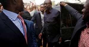 George Weah, former soccer player and presidential candidate of Coalition for Democratic Change (CDC), arriving at his party's headquarters in Monrovia, Liberia on Wednesday. Photograph:  Thierry Gouegnon/Reuters