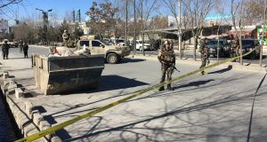 Afghan security forces stand guard near the site of multiple blasts in Kabul on Thursday. Photograph: Getty