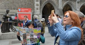 Tourists in Dublin at the Molly Malone statue. Photograph: Alan Betson