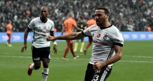Besiktas striker  Cenk Tosun celebrates a goal against Galatasaray in a Turkish league game in Istanbul earlier this month. Photograph: Ozan Kose/AFP/Getty