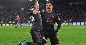 Arsenal's Alexis Sanchez celebrates with Hector Bellerin after netting his side's third goal during their Premier League clash with Crystal Palace. Photo: Ben Stansall/Getty Images
