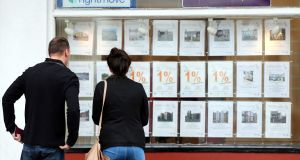 A couple looking at houses for sale in a estate agent's window. Net mortgage lending in the Irish economy has increased for the first time in seven years, reflecting the current pick-up in activity in the housing market. Photograph: Peter Byrne/PA Wire