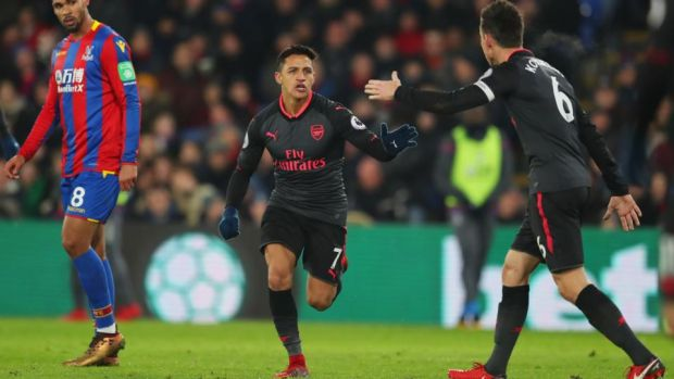 Alexis Sanchez celebrates Arsenal's second goal against Crystal Palace with Laurent Koscielny. Photograph: Catherine Ivill/Getty
