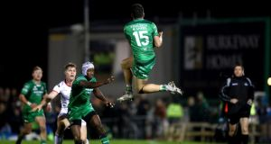 Home-grown talent Tiernan O'Halloran in action for Connacht against Ulster at the  Sportsground as team-mate Niyi Adeleokun, who was born in Nigeria, looks on. Photograph: James Crombie/Inpho