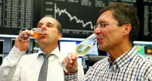Bourse traders drink champagne after the last trading day at Frankfurt's stock exchange. Photograph: Reuters/Ralph Orlowski