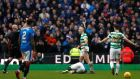 Scott Brown is booked towards the end of Celtic's goalless draw with Rangers. Photograph: Russell Cheyne/Reuters