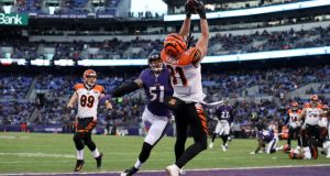 Cincinnati Bengals  tightend Tyler Kroft  catches a touchdown in the first quarter against Kamalei Correa  of the Baltimore Ravens at M&T Bank Stadium. Photograph: Patrick Smith/Getty Images