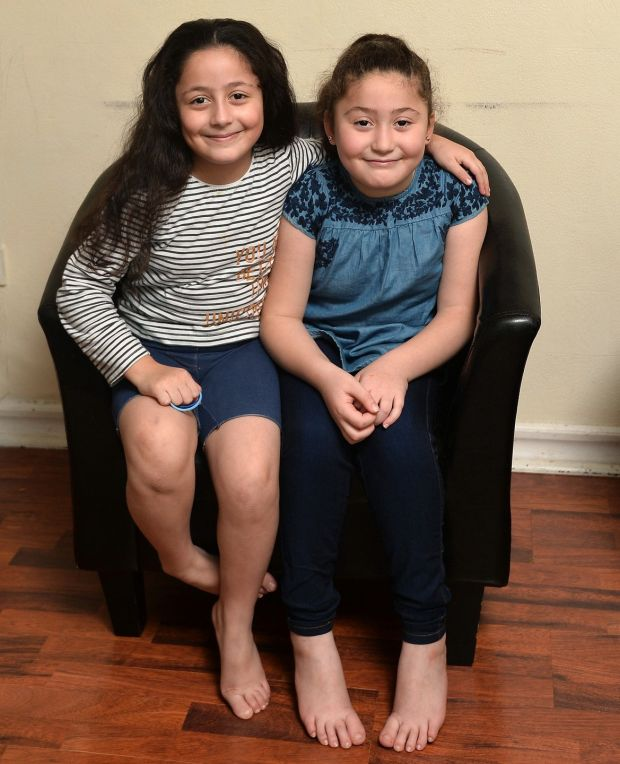 Aya (left) and Fatima at their Belfast home. Photograph: Colm Lenaghan/Pacemaker