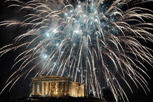 Fireworks explode by the Ancient Acropolis in Athens during the New Year celebrations on December 31, 2017.  PHOTO /LOUISA GOULIAMAKI/AFP/Getty Images