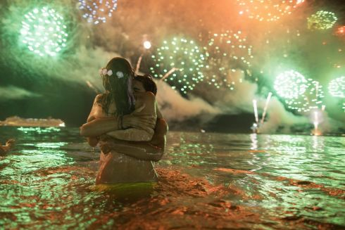 A couple hug each other as they watch fireworks exploding over Copacabana beach during New Year's celebrations in Rio de Janeiro, Brazil, Monday, Jan. 1, 2018. (AP Photo/Leo Correa)