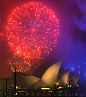 Fireworks explode over the Opera House during New Year's Eve celebrations in Sydney, Australia. Photo: David Moir/AAP Image via AP
