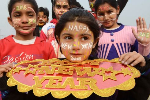 Indian children with their faces painted pose for a picture to welcome the New Year 2018 in Amritsar on December 31, 2017. PHOTO / NARINDER NANU/AFP/Getty Images