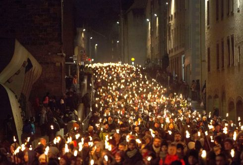 The Torchlight Procession which marks the opening of Edinburgh city's New Year celebrations, makes its way through the city accompanied by a cast of pipers and drummers starting at St Giles cathedral and making its way down the Royal Mile towards Holyrood Park. Photo: David Cheskin/PA Wire