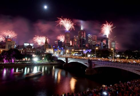 Fireworks light up the sky from building rooftops along the Yarra River during New Year's Eve celebrations in Melbourne early on January 1, 2018. Photo:  Mal Fairclough/AFP/Getty Images