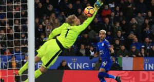 Leicester City's  Riyad Mahrez scores  his side's  first goal past Huddersfield Town's goalkeeper Jonas Lossl during the  Premier League  match  at the King Power Stadium. Photograph: Lindsey Parnaby/AFP