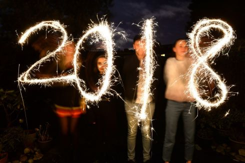 LIGHT UP: Cliona Nic Dhomhnaill, Orla Morrison, Cian Mac Donaill and Triona Nic Dhonaill celebrate the new year with sparklers in Dublin. Photograph: Dara Mac Dónaill/The Irish Times