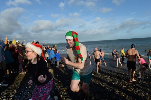 GOING SWIMMINGLY: People take part in the Bray new year's swim, in Co Wicklow. Photograph: Dara Mac Dónaill/The Irish Times