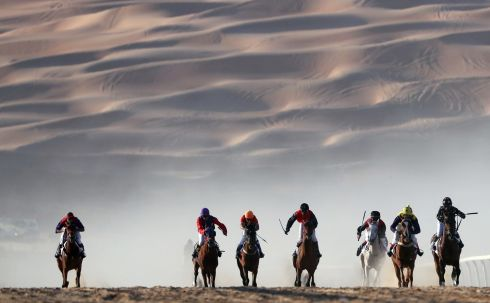 RUN INTO THE SAND: Jockeys compete in a race for purebred Arab horses during the Liwa 2018 Moreeb Dune Festival, some 250km west of Abu Dhabi. Photograph: Karim Sahib/AFP/Getty Images