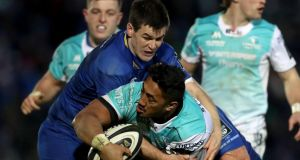 Johnny Sexton tackles Bundee Aki during Leinster's win over Connacht. Photograph: Bryan Keane/Inpho