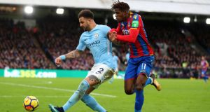 Kyle Walker of Manchester City and Wilfried Zaha of Crystal Palace  at Selhurst Park, London,  on December 31st. Photograph:   Catherine Ivill/Getty Images