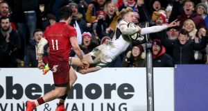 Rob Lyttle scores Ulster's fourth try during the Guinness Pro 14 game against Munster at Kingspan Stadium. Photograph: Brian Little/Inpho