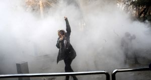 Iranian students clash with riot police during an anti-government protest at the University of Tehran. Photograph:  EPA/STR