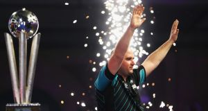 Rob Cross celebrates his World Championship win against Phil Taylor. Photogrpah: Naomi Baker/Getty