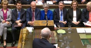 British prime minister Theresa May and members of her front bench react as Labour  leader Jeremy Corbyn speaks during Prime Minister's Questions in the House of Commons. Photograph:  PA Wire