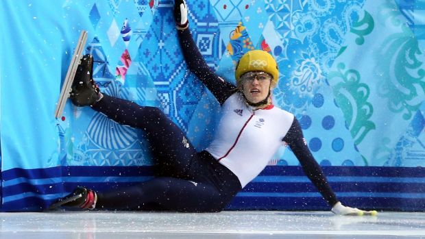 Britain's Elise Christie crashes out of the 1,000m semi-finals in Sochi. Photograph: Clive Mason/Getty Images