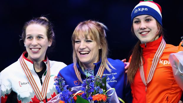 Elise Christie celebrates 1000m gold in Rotterdam with Canada's silver medallist Marianne St-Gelais (L) and Suzanne Schulting of the Netherlands who took bronze. Photograph: Dean Mouhtaropoulos/Getty