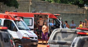 Injured prisoners receive medical care in an ambulance after the riot at the Colonia Agroindustrial prison. Photograph: AP.