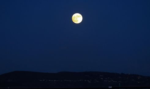 New Year's Day moon as viewed from sandymount looking towards Howth.  Photograph Nick Bradshaw / The Irish Times