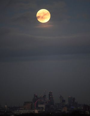 A 'supermoon' full moon is seen rising above the skyline of London. Photograph:  Toby Melville / Reuters