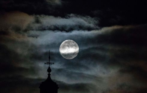 A 'Full Wolf Moon'  rises by County Hall in London. Photograph: Neill Hall / EPA