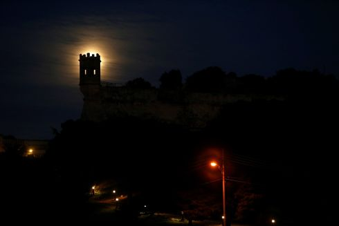 A 'supermoon' full moon rises behind the guard tower on the 17th century San Salvatore Bastion in Pieta, Malta.  Photograph: Darrin Zammit Lupi / Reuters
